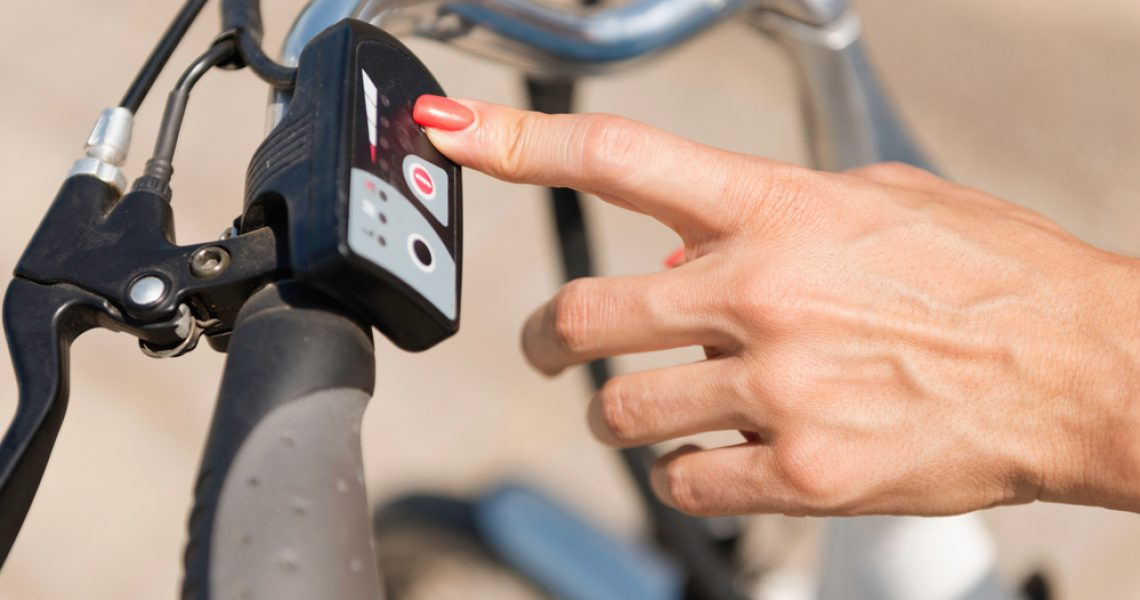 Pressing a button on e-bike control board